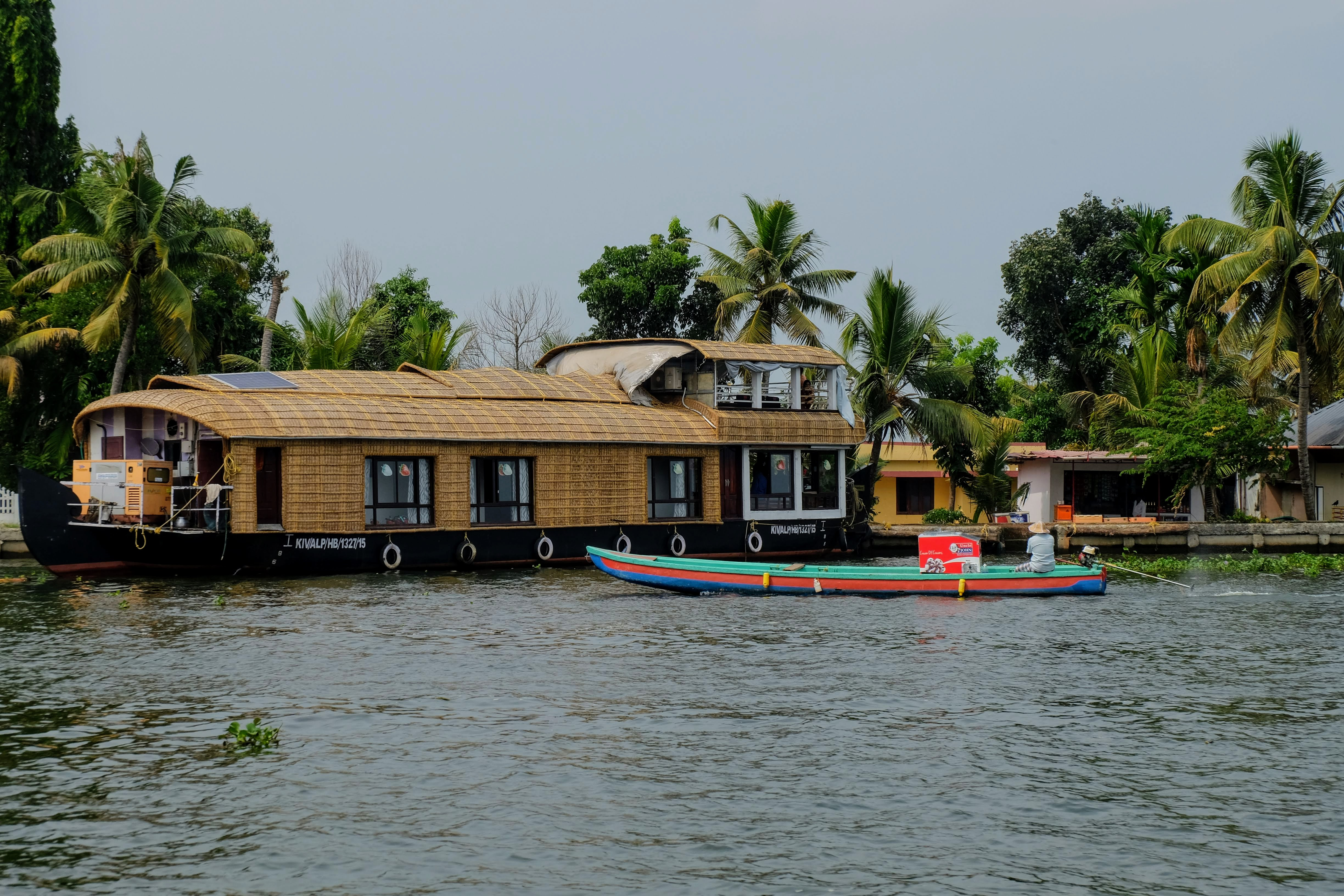 A houseboat and a motorised canoe in Kerala