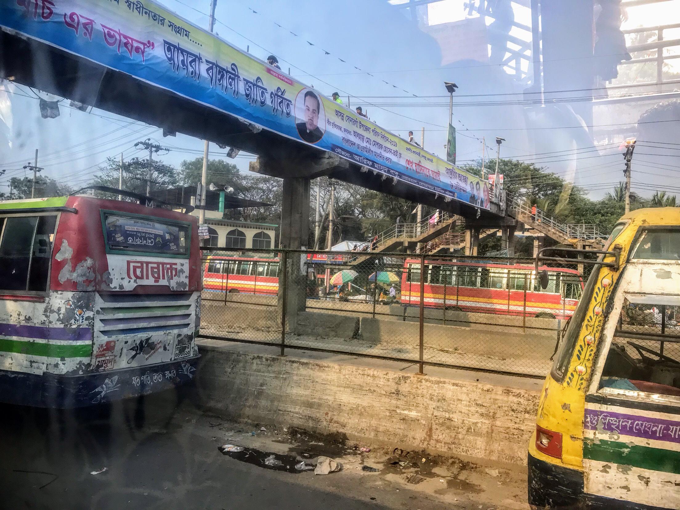 Mograpara bus stop for Dhaka, Bangladesh