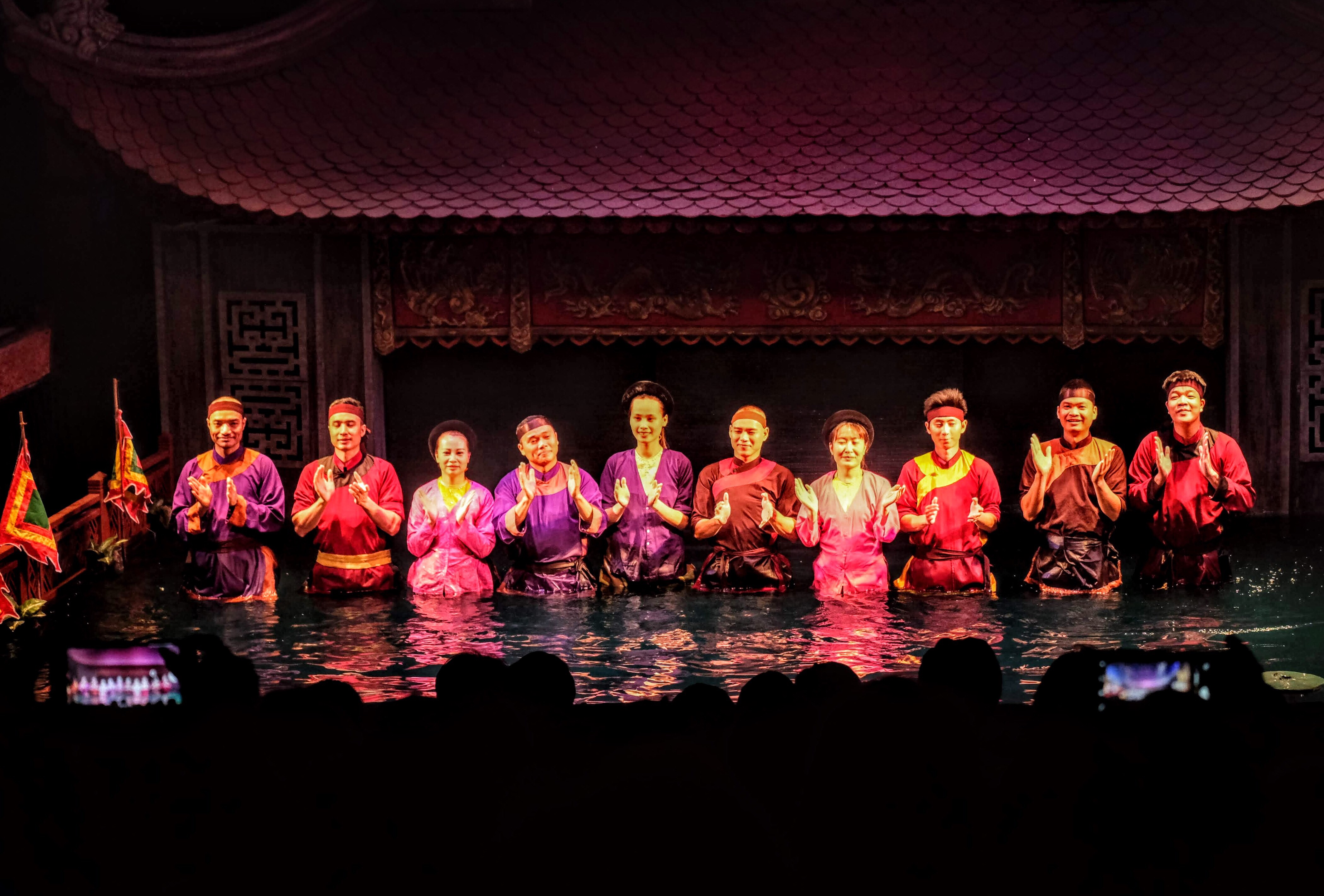 Puppeteers at the water puppet theatre, Hanoi, Vietnam