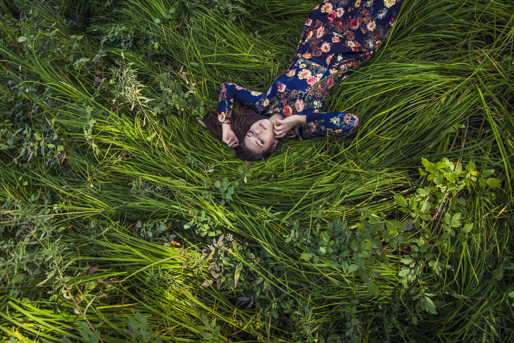 Woman relaxes in the grass
