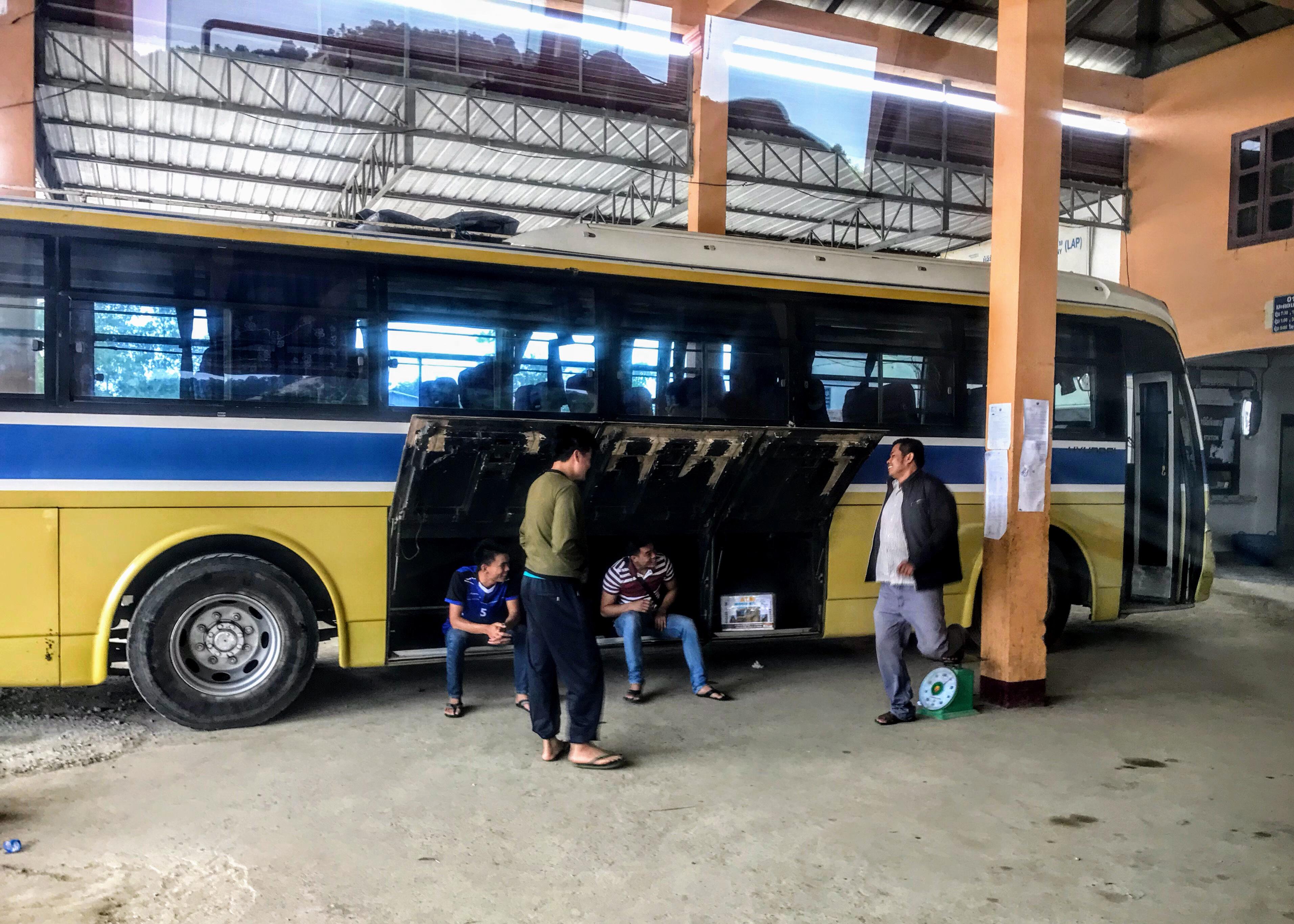 Men weighing themselves at Xam Neua bus station