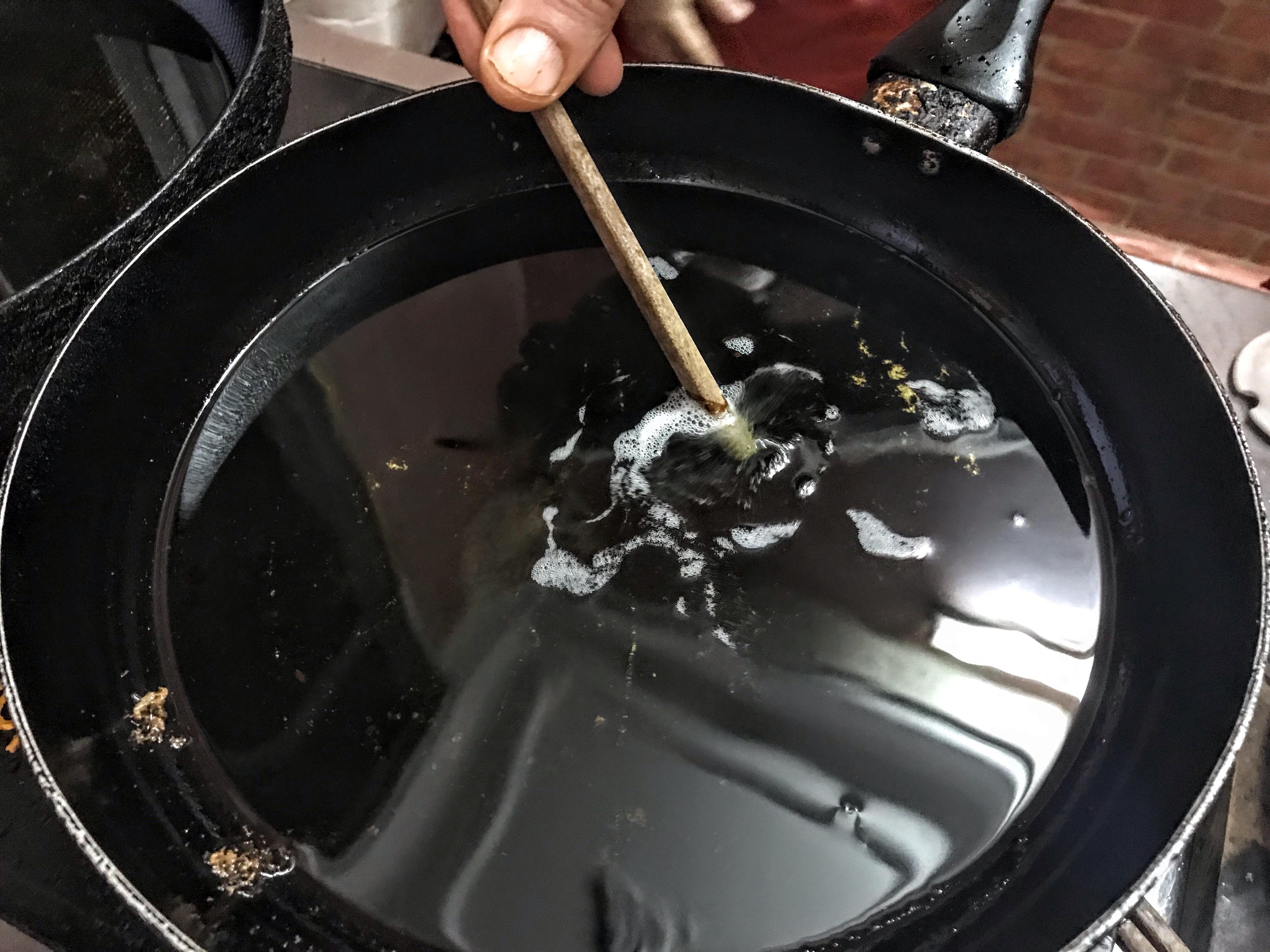 Testing the oil, Hanoi, Vietnam