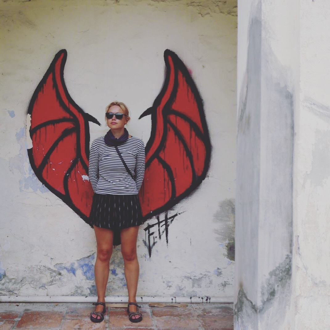 Posing with bat wings, George Town, Malaysia