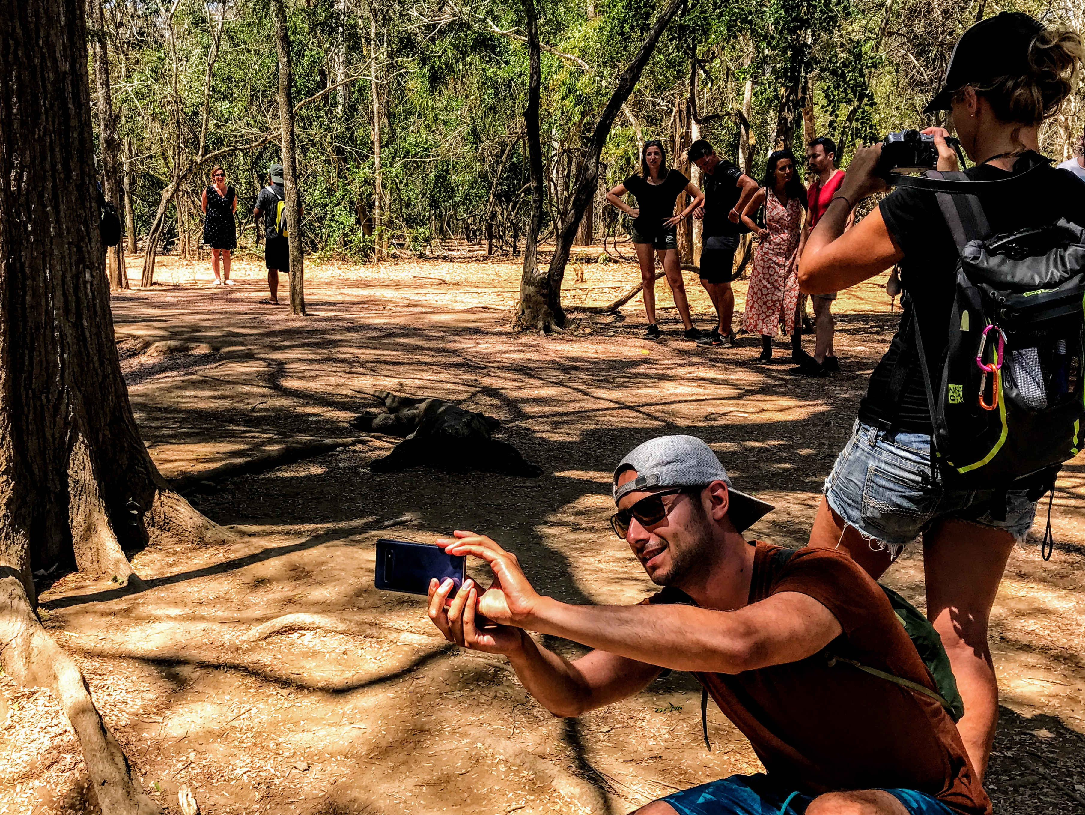 Tourist taking a selfie with a Komodo Dragon, Indonesia