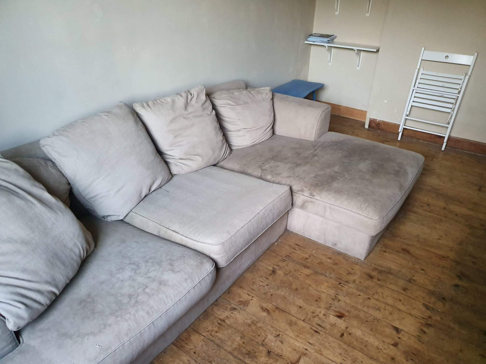 Before: Stained beige sofa