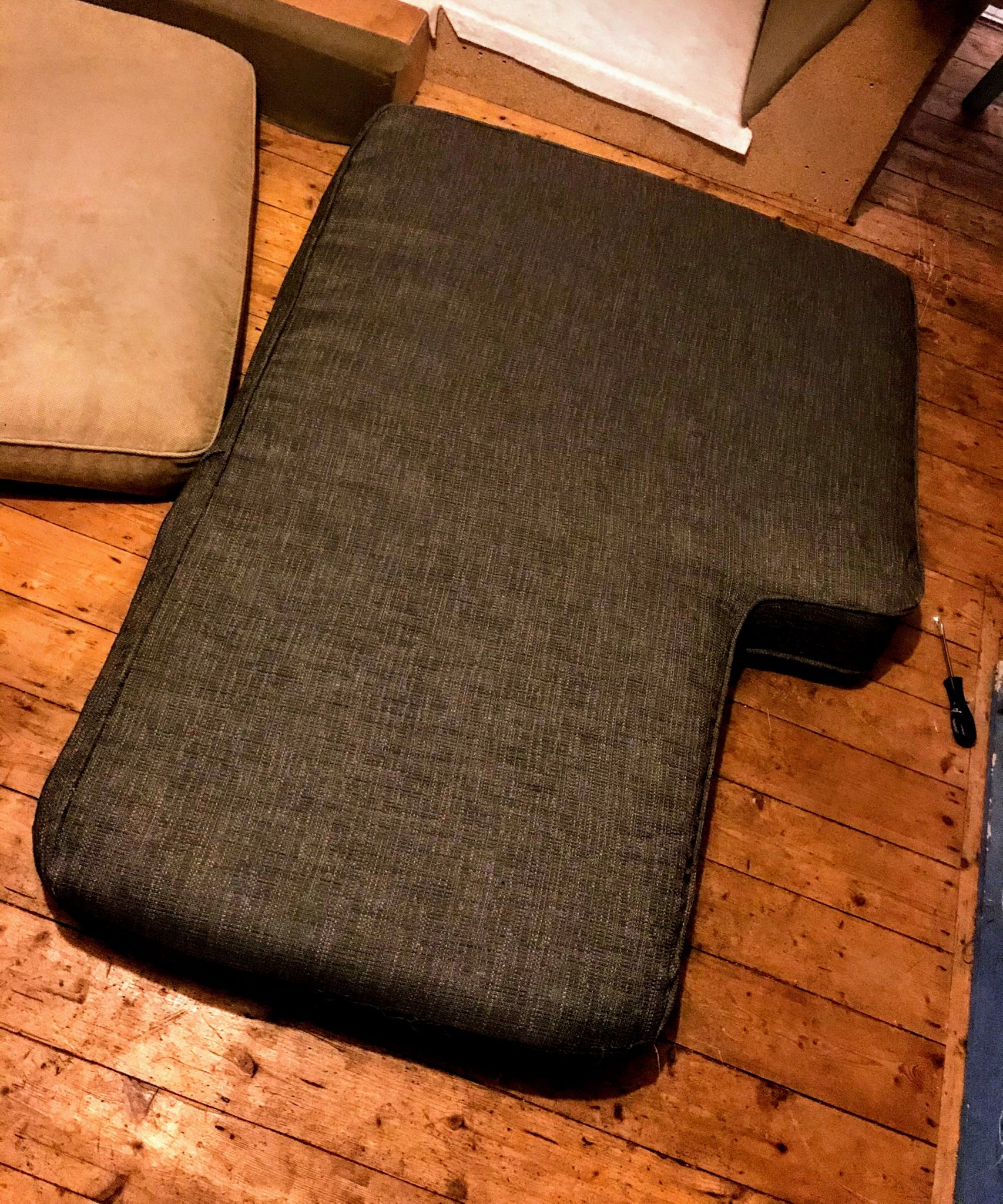 Large piped sofa cushion